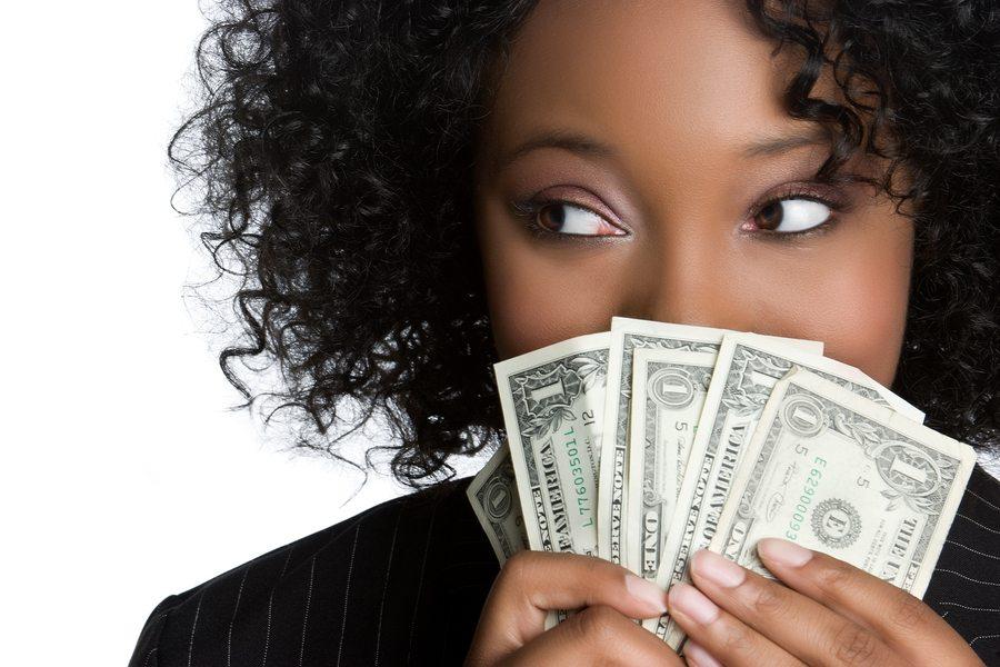 bigstock-Woman-Holding-Money-12035813