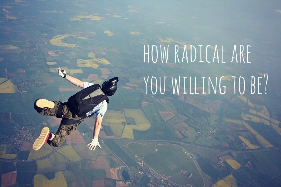 Solo skydiver in freefall high up in the air